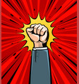 clenched fist raised up cartoon in pop art retro vector image