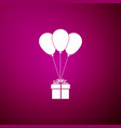 gift box with balloons icon on purple background vector image vector image