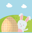 cute rabbits with easter egg painted in the field vector image vector image