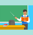 indian teacher with book near blackboard in class vector image vector image