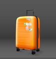 orange travel bag on grey background travel vector image