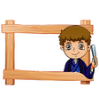 A wooden frame with a young boy vector image vector image