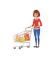 cartoon woman standing near supermarket cart with vector image vector image
