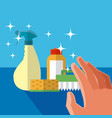 hand grabbing cleaning products vector image