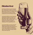 hand with glass of beer oktoberfest banner vector image vector image