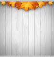 wooden background with autumn leaves place vector image vector image