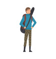 male tourist standing with backpack and guitar vector image vector image