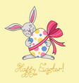 easter bunny is holding egg in paws vector image vector image