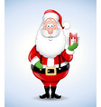 happy cartoon santa claus holding a gift vector image vector image
