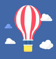 hot air balloon in the night sky with clouds vector image