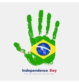 Handprint with the Flag of Brazili in grunge style vector image vector image