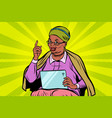 african elderly woman with a tablet vector image vector image