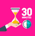thirty minutes clock with hourglass vector image vector image