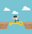 cross the cliff with key to success vector image