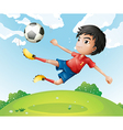 A football player in his red uniform kicking the vector image vector image