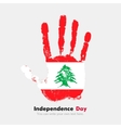 Handprint with the Flag of Lebanon in grunge style vector image vector image