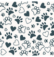 Seamless pattern with paw and heart prints Animal vector image vector image
