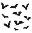 flock of bats black shadows of bats on a white vector image