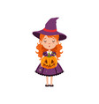 young red-haired girl witch standing with pumpkin vector image vector image