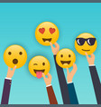 hand holding reaction smileys social media vector image vector image