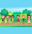 happy children holding hands in summer park vector image