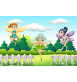 Three fairies flying in garden vector image vector image