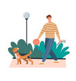 young man taking his dog for a walk vector image vector image