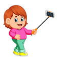 young woman using selfie stick vector image vector image