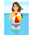 woman holding an inflatable striped ball vector image