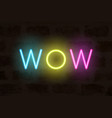 neon letters on brick wall wow word vector image