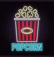 retro neon popcorn sign on brick wall background vector image