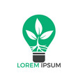 Logo template with plant growing inside light bulb