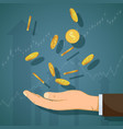 human hand catches gold coins vector image