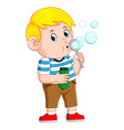 cute boy is playing and blowing the bubble vector image