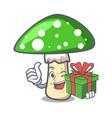with gift green amanita mushroom mascot cartoon vector image vector image