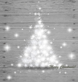 Christmas tree on wood background vector image
