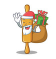 santa with gift rolling pin character cartoon vector image vector image