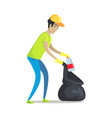 guy cleans garbage with rubber gloves and pack vector image