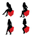 girl silhouette sitting on cube red set vector image vector image