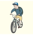 School boy riding bmx bycicle vector image