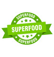 superfood ribbon superfood round green sign vector image vector image