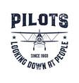 vintage airplane emblem pilots looking down vector image