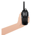 hand with realistic walkie talkie vector image vector image