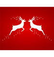 Reindeer silhouettes on a red background vector image vector image