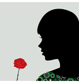 Girl smelling a rose vector image