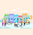 people sit and relax at tables at open air cafe vector image vector image