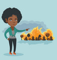 woman standing on the background of wildfire vector image vector image