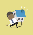 businessman carry his house debt with chained vector image vector image