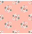Grunge circles on a light coral background vector image vector image