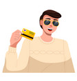 man holding a credit card in his hand smiling vector image vector image